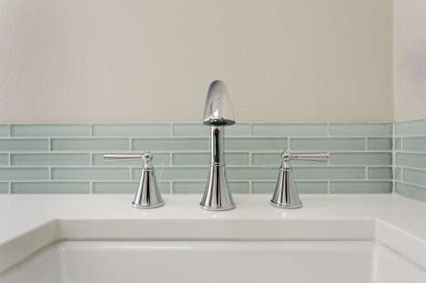 A bathroom sink with fixture